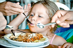 Feeding Miss Ria (Truebritgal) Tags: food girl lens lunch hands toddler funny child feeding sauce candid cyprus plate fork spoon bowl pasta meat napa feed amusing spaghetti serving ria bolognese ayianapa goldenbay agia 18200mm truebritgal