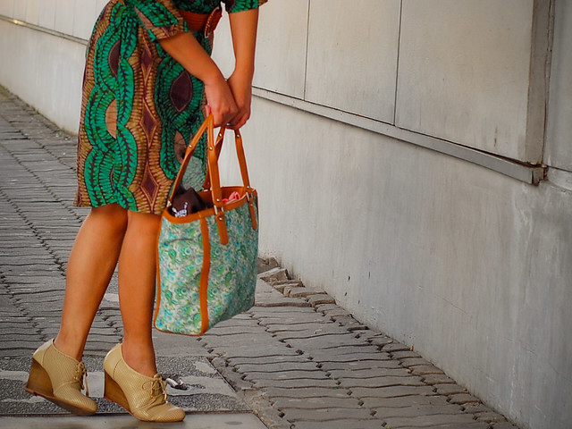 green dress, green bag, nude wedge booties