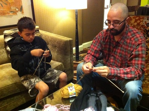 Cement truck driver/ knitter brought his son to the Beginner Lounge to learn. Love it! #VKLive