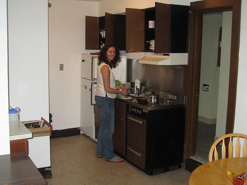 A bad picture of me cooking in our tiny kitchen