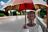 The Age Factor ii (bijoyKetan) Tags: old red portrait man umbrella bangladesh ketan panchagarh canonef70200mm28is debiganj bijoyketan