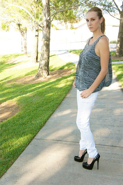 White jeans and gray zebra top