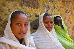 Girls in Gorgora, Ethiopia (NeSlaB .) Tags: poverty africa portrait woman colors canon religious photo eyes women christ faith prayer religion young clothes christianity ethiopia orthodox rite pilgrim rites developingcountries reportage pilgrims debre etiopia amhara gorgora neslab