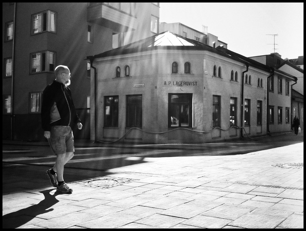 Man with bear and shorts walking, Uppsala, Sweden