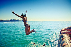 JUMP (baxcarias) Tags: blue light sea woman holiday hot color green beach girl 30 swim canon fun star pier goodness high interesting jump hands october brighton flickr lol turquoise fast palace 2nd suit explore bikini abandon 600 heat shutter swimmer record usm 29 excitement swimsuit groyne tone swimwear degrees celsius 3500 2011 colorphotoaward 1585mm