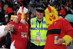 Welsh fans pose with a policeman 15/10/2011