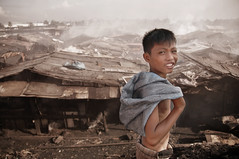 Ulingan, Tondo - Remel and his home (Mio Cade) Tags: poverty boy kid factory child philippines charcoal manila labour remain sponsor sponsorship tondo remel ulingan