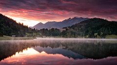 Dawn (andywon) Tags: trees light red sky mist lake mountains alps nature water clouds sunrise reflections germany landscape bavaria fire mirror hut karwendel wallgau geroldsee wagenbrchsee gettygermanyq3