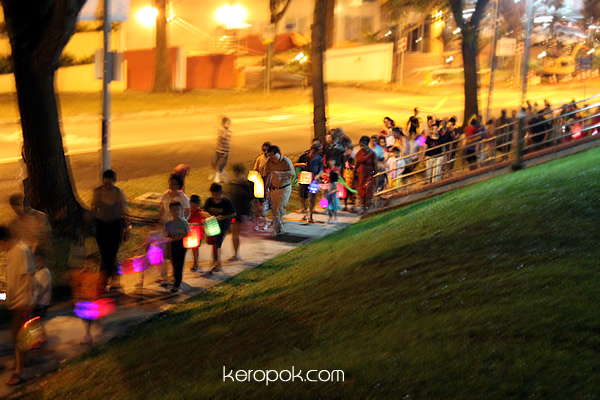 Kids carrying lanterns...