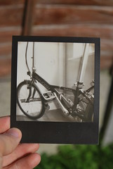 my bike! :D (Ben Wolfarth) Tags: old portrait white house black up bike vintage silver project lens polaroid lomo lomography focus soft close ride uv flash border raleigh retro sharp plastic shade single 600 cycle instant element folding impossible impulse bycycle rapide px px600