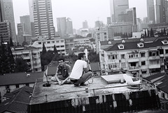 Rooftop (Woods | Damien) Tags: china roof blackandwhite film shanghai noiretblanc rangefinder   rue kodaktmax400 argentique olympus35sp jingandistrict  shanghaiflickrmeetup