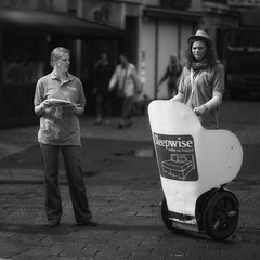 Supervising (Fouquier ) Tags: blackandwhite bw white black mono streetlife segway explored canonef85mmf12liiusm canoneos5dmkii