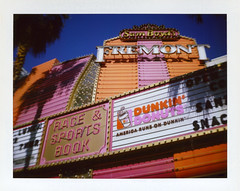 Fremont (Nick Leonard) Tags: city morning pink vegas summer orange white gambling classic film beautiful sign analog vintage polaroid downtown neon fuji lasvegas nevada nick lightbulbs fremont scan retro gaming signage fujifilm fremontstreet dunkindonuts landcamera packfilm fremontstreetexperience filmphotography polaroidlandcamera colorfilm instantfilm samboyd epson4490 fremontcasino fremonthotel fujifp100c americarunsondunkin raceandsportsbook peelapartfilm nickleonard polaroid100automaticlandcamera