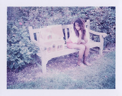 is there a ghost (kat.clark) Tags: roses college girl dreadlocks garden bench polaroid kat boots pennsylvania pa fairy clark swarthmore swarthmorecollege expired tale dollhouse 669 iduv katclark