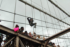 Climbing the Cables (eqqman) Tags: march protest brooklynbridge occupywallstreet