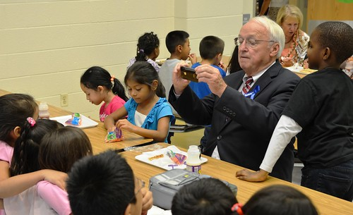 Under Secretary Kevin Concannon takes a photo of his lunch mates last month at Arcola Elementary School in Silver Spring, Md.  Concannon presented all 132 Montgomery County Elementary Schools with Healthier US Schools Challenge Bronze awards.