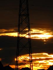 Pylon # 9 (David Alexander Beedie) Tags: sunset rooftops powerlines pylons