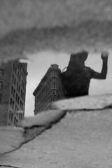 nyc (robincerutti) Tags: new york city nyc urban reflection building puddle iron escape flat manhattan inside 2011 robincerutti