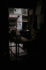 Chai (brightasafig) Tags: india waiting solitude quiet darkness tea delhi passing chai olddelhi turkmangate shahabulkhermarg