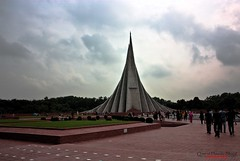 National  Martyrs Monument (Shajal1) Tags: life old pink flowers blue trees red sky cloud white black flower color tree green monument nature beautiful beauty yellow closeup canon wonderful butterfly dark lens landscape eos golden evening boat fly flying leaf amazing nice colorful village shot samsung 300mm 55mm national disk dell intel excellent lovely martyrs core 18mm 75mm supershot i7 caonon 70mm300mm 450d 18mm55mm