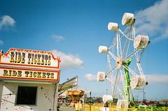 (sarah hall.) Tags: carnival sky film clouds ferriswheel amusementpark tornado ticketbooth thomasamusements tornadoride