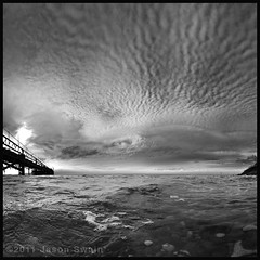 Fish. (s0ulsurfing) Tags: uk sea england sky blackandwhite bw panorama white black english beach water silhouette clouds contrast canon island photography grey mono coast pier britain shoreline monotone calm coastal shore isleofwight 7d change coastline british serene isle atmospheric wight fishandchips altocumulus totland mackerelsky 2011 s0ulsurfing thecloudappreciationsociety thecloudspottersguide totlandpier coastuk vertorama canon7d jasonswain