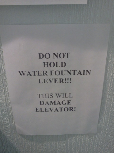 DO NOT HOLD WATER FOUNTAIN LEVER!!! THIS WILL DAMAGE ELEVATOR!