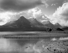 Ben Loyal, Sutherland, Scotland (welshio) Tags: travel light wild sky blackandwhite bw mountain lake storm film water clouds reflections reeds landscape scotland ben horizon north perspective landmarks dramatic stormy cliffs scan vista romantic remote loch wilderness peaks sublime sutherland picturesque farnorth largeformat zonesystem northcoast 5x4 naturallandscape seaandsky benloyal scottishlandscape britishlandscape ribigill classicviews