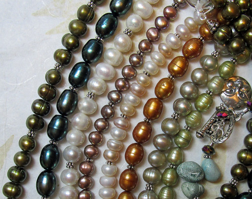 various pearl sets and a bracelet