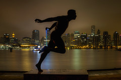 Harry Winston Jerome Statue in Stanley Park Vancouver BC at Night 2 - HDR (David Gn Photography) Tags: city sky canada reflection silhouette statue skyline night buildings lights memorial downtown cityscape skyscrapers britishcolumbia famous scenic sigma stormy canadian seawall rainy stanleypark 50th runner canadaplace vancouverbc hdr coalharbour trackandfield harbourcenter 3xp harrywinstonjerome summerolympics worldrecords hallelujahpoint canoneos7d sigma2470mmf28ifexdghsm
