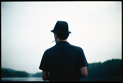 Tom. (Vitaliy P.) Tags: new york trees portrait lake color tree film hat tom analog 35mm 50mm back nikon kodak thomas f14 cigarette candid smoke upstate tommy scan smoking line iso professional explore negative epson fedora v600 fm10 portra ais unprocessed noediting 160 160nc noprocessing explored vitaliyp