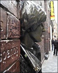 lennon's liverpool ..... (ana_lee_smith) Tags: street uk travel england people sculpture tourism statue wall bronze liverpool photography photojournalism signage pedestrians eleanor stanleystreet johnlennon sculptor mathewstreet thebeatles rigby merseyside beatlemania walloffame thecavern tommysteele allthelonelypeople analeesmith photosofliverpool sonyslta33