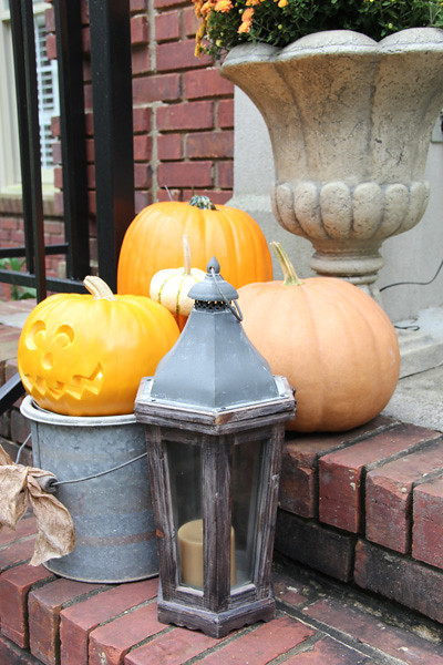 pumpkins and lanterns for fall front porch