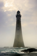 Chicken Rock Lighthouse through the fog, Isle of Man (iancowe) Tags: lighthouse mist man tower chicken rock misty fog pillar foggy stevenson calf isleofman manx portstmary northernlighthouseboard nlb calfofman chickenrock lighthousetrek wbnawiman