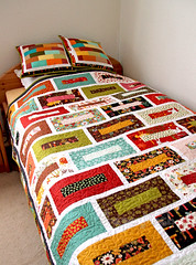 'Brick wall' quilt and pillows finished (3) (ShapeMoth) Tags: autumn red orange white geometric quilt olive pillow brickwall fallcolours jellyroll konacotton modernquilt patchwok shapemoth