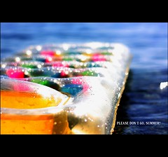 Don't knock the weather. If it didn't change once in a while, nine out of ten people couldn't start a conversation. (*karla) Tags: sea summer colour beach water canon 50mm dof bokeh inflatablemattress