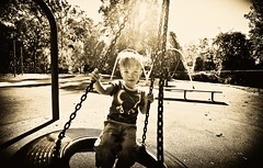 292:365 - Summer Stays With Him (andrewsulliv) Tags: blackandwhite sun playground joy swinging 1635mm october20 project365 project365293 3652011