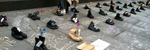 Shoes of those now dead - worn by people Killed by Our Govt.