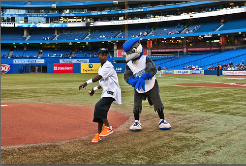 16-year-old Joseph from Haiti pitches the ball at his first Blue Jays game