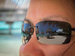 Paradise Reflection (NUkiwi) Tags: sea reflection cute beach girl sunglasses nose paradise pacific hilton tahiti moorea hiltonmoorea