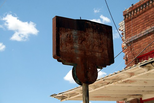 ghostly dr. pepper sign in baird