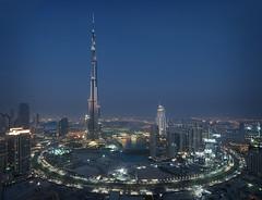 Beautiful Dubai #3 (momentaryawe.com) Tags: city urban skyline skyscraper buildings reflections evening high dubai uae middleeast aerial tall bluehour unitedarabemirates tallest burjdubai businessbay d300s theaddress catalinmarin momentaryawecom burjkhalifa