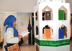 Visitor browsing through different translations of Holy Quran displayed at the Exhibition (Ahsan Ghouri) Tags: islam exhibition quran holyquran ahmadi ahmedi qadian constitutionalclub ahmadiyyat quranandscience quranexhibition islamscience islamandscience constitutionalclubofindia