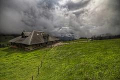 Over The Hills (Philippe Saire || Photography) Tags: sky house mountain alps nature clouds montagne alpes canon landscape eos switzerland suisse farm swiss sigma wideangle explore ciel 7d 1020mm nuages paysage maison hd