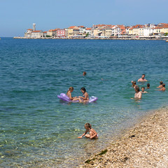 Playful swimming at Piran's coast with colorful buildings (Bn) Tags: old sea lighthouse streets heritage beach church architecture swimming swim square geotagged coast town topf50 colorful mediterranean child gulf cathedral pirates gothic charm historic slovenia era tribes punta venetian walls piran slovenija peninsula viewpoint picturesque playful narrow cultural adriatic chlldren buidlings alleys istria slovene pirano sloveni tartini istrian preroman histri 50faves giuseppi illyrian stklement georgius obzidje gulfofpiran piransko geo:lon=13566730 geo:lat=45523107