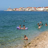 Playful swimming at Piran's coast with colorful buildings (B℮n) Tags: old sea lighthouse streets heritage beach church architecture swimming swim square geotagged coast town topf50 colorful mediterranean child gulf cathedral pirates gothic charm historic slovenia era tribes punta venetian walls piran slovenija peninsula viewpoint picturesque playful narrow cultural adriatic chlldren buidlings alleys istria slovene pirano slovenië tartini istrian preroman histri 50faves giuseppi illyrian stklement georgius obzidje gulfofpiran piransko geo:lon=13566730 geo:lat=45523107