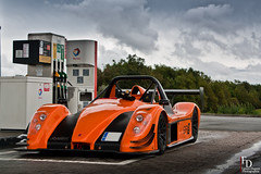 Radical SR3 SL (Fabien.Dupont) Tags: auto england orange sun france car canon de french photography la soleil photo juin crazy automobile photographie shot d tunnel super spot sl esplanade radical mm 12 lille 18 55 pas dupont find channel spotting calais manche nord eurotunnel sous fabien sr3 rassemblement 450d