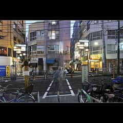 The crossing (Laurent T (aka thery_lg)) Tags: street longexposure urban bicycle japan night tokyo nightshot tram rail rue nuit tramway japon urbain ootsuka poselongue