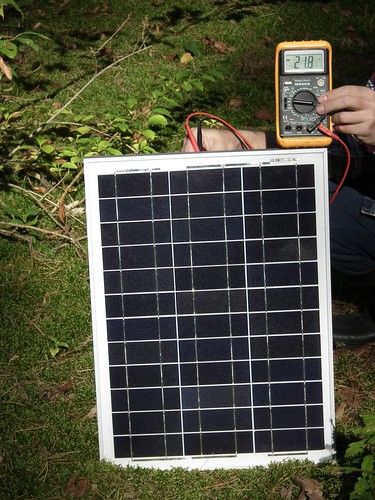 Measuring Voc of the tested solar panel.