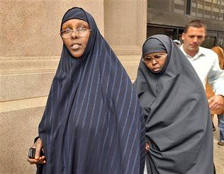 Two Somalian-American women, Amina Farah Ali and Hawo Mohamed Hassan, have been charged with providing money to Al-Shabaab from Somalia. Ali has now been charged with contempt of court and jailed for refusing stand for the judge. by Pan-African News Wire File Photos